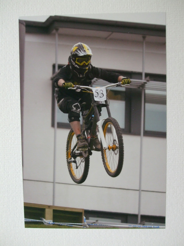 Photographic greetings card of a downhill bike racer, number 53.
