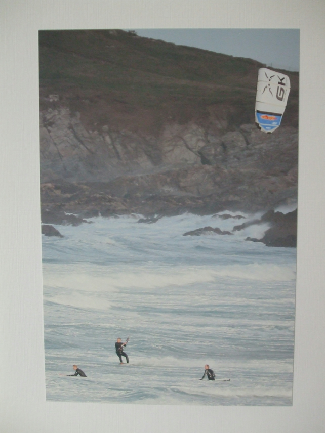Photographic greetings card of a kite surfer with 2 surfers.
