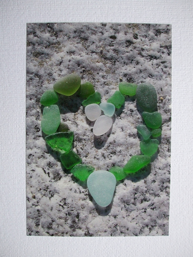 Portrait photographic card of a heart shape in sea glass.