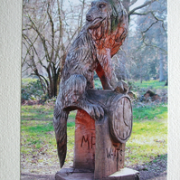 "Photographic greetings card of ""Mr. Wolf"" in chain-saw art."