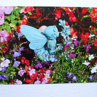 Photographic greetings card of our Fairy smelling the flowers.