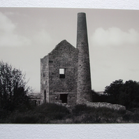 Photographic greetings card of Wheal Peevor Tin Mine in monochrome.