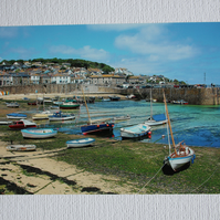 Photographic greetings card of Mousehole harbour at low tide.