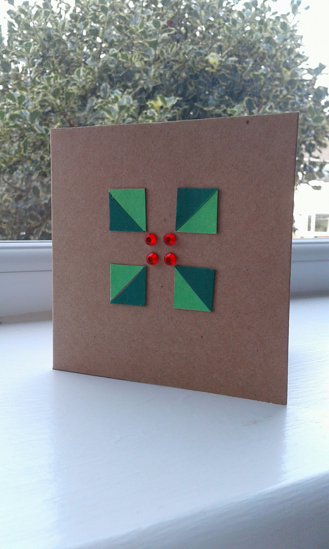 Stylized holly and gems Christmas card
