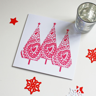 Christmas card, hand printed trees in red on a white card