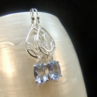 Blue Topaz Oval Claw Setting Sterling Silver Earrings