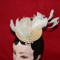 Straw fascinator with with ivory feathers and pearls