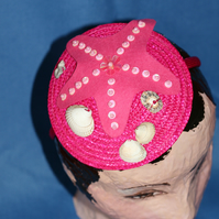 Hot pink straw fascinator with starfish and seashells