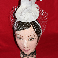 White straw fascinator with feathers and veil