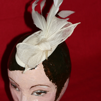 Straw ivory fascinator with bow and feathers