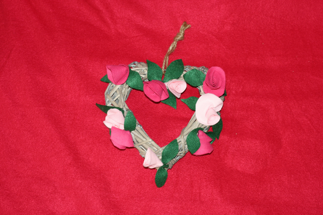 Wicker heart shaped wreath with pink roses