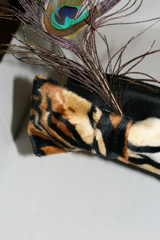 Black hat with tiger bow and peacock feather