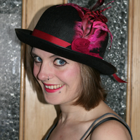 Black bowler steampunk hat with roses and feathers