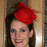 Red mini top hat with feathers and tulle