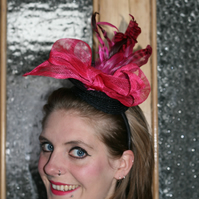 Black fascinator with hot pink bow and feathers
