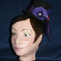 Black felt top hat with purple poppies and bow