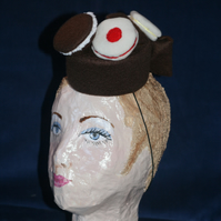 Brown felt biscuit fascinator
