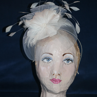 White feather and tulle fascinator