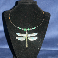 Large metal dragonfly necklace on silver plated neck wire