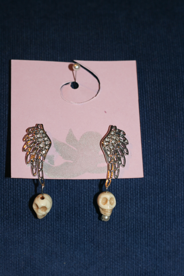 Wing and skull earrings