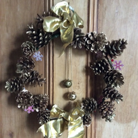 Gold wreath with fir cones and bells