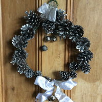 Silver wreath with fir cones and bells