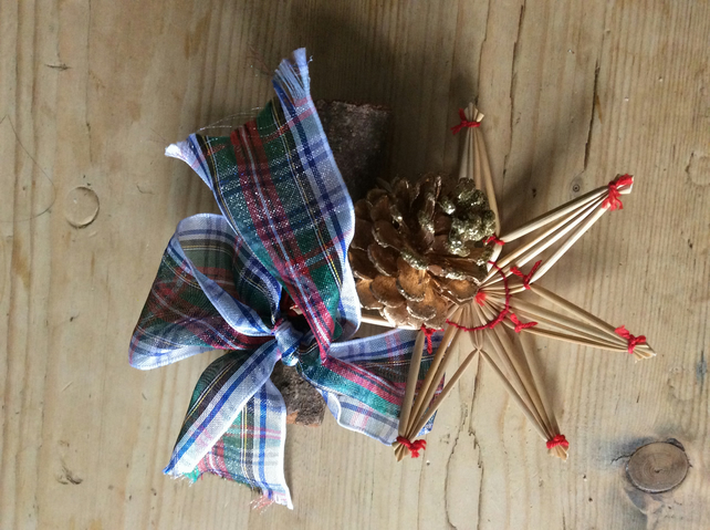 Cinnamon stick, ribbon and star decoration