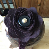 Brown velvet headband with flower and button