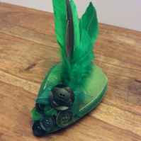 Green fascinator with Art Deco buttons and feathers