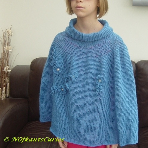 Floral Polo Poncho!  Crocheted with structural floral embellishments.