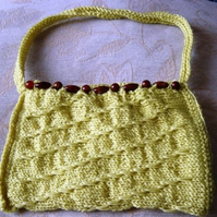 Spring Bead Hand Knitted & Crocheted Petite Handbag with bead detail.