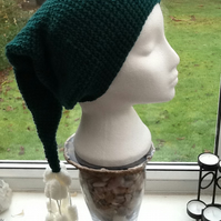 Deep Green Elf Style Hat with Pom Pom looping Tassel detailing.