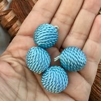 Set of Four Silk Cord Covered Globe Toggle Buttons.