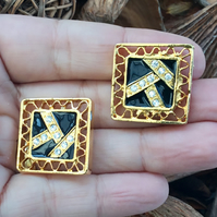 Pair of Black and Gold tone Enameled buttons with Faceted Crystals.