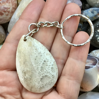 Pretty Teardrop Shaped Chrysanthemum Fossil Coral Keyring or Handbag Charm.