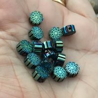 Set of 15 Peacock Tones Floral Carved Hematite Gemstone Beads.