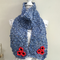 Emblem!  A Soft Mottled Blue Chunky Crocheted Scarf with Floral Accent Detail.