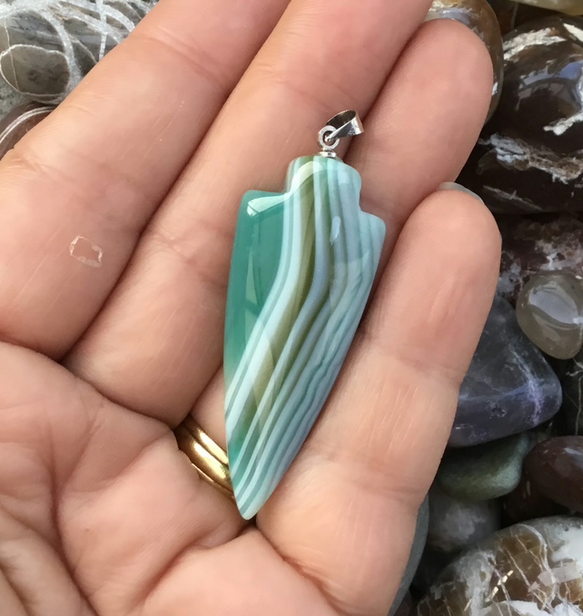 Ice Blue Striped Agate Arrowhead Pendant with Silvertone Bail.