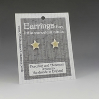 Twinkle star stud earrings handmade porcelain, yellow glazed.