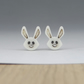White rabbit stud earrings handmade porcelain, natural oxide highlights.