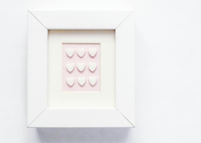 Little porcelain love hearts in a white frame