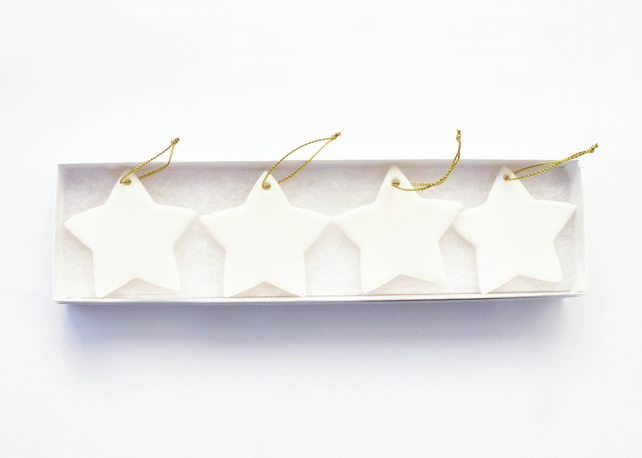 Set of 4 white porcelain stars, Christmas decorations