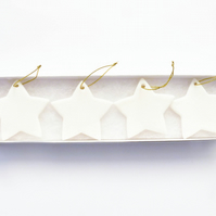 Set of 4 white porcelain stars