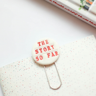 """The story so far"" porcelain bookmark, large paperclip"