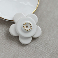 Ceramic white and gold flower brooch