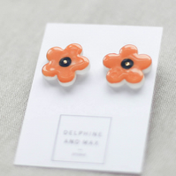 Orange ceramic daisy earrings