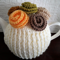 Tea Cosy Medium in the colour Cream with Flowers on top.