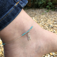 Dream catcher & seed bead floating anklet. Sterling silver.