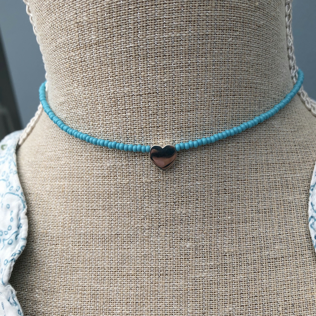 Mid blue seed bead choker with sterling silver heart.