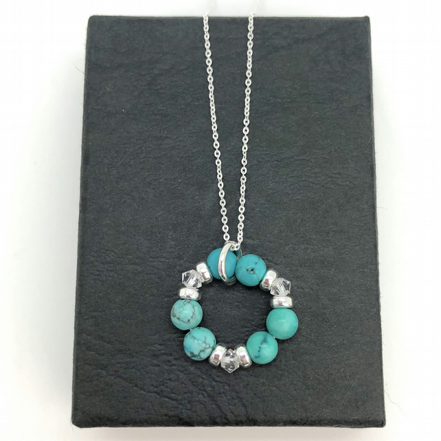 Turquoise and Swarovski Crystal Circle of life pendant. Sterling Silver